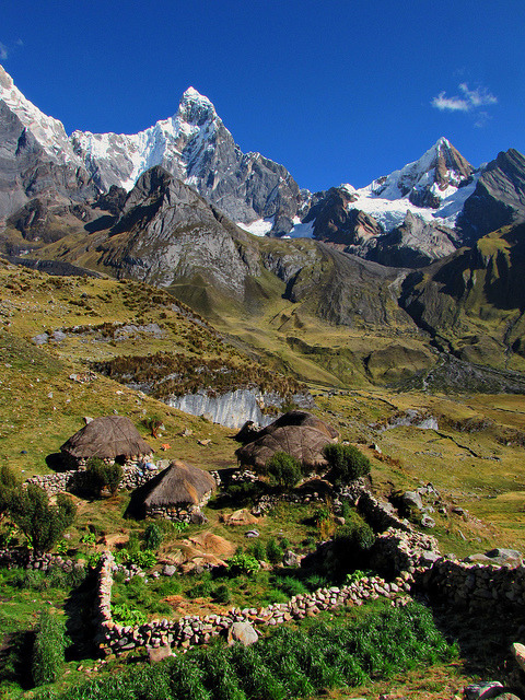 by mikemellinger on Flickr.Traditional houses at the footsteps of Cordillera Huayhuash in Peru.