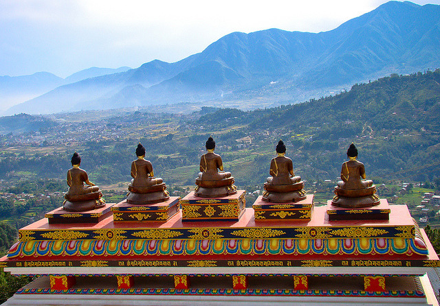 by Tilak Thapa on Flickr.Five Buddhas on the top of Amitabh Monastery in Nepal.