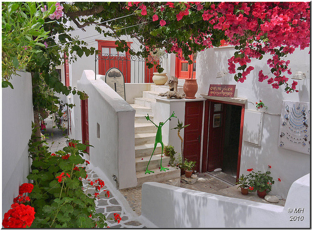 Colourful flowers surrounding a cafe and gift shop in Naxos, Greece