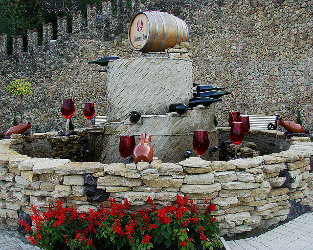 Red wine fountain outside the biggest wine cellars in the world in Milestii Mici, Moldova