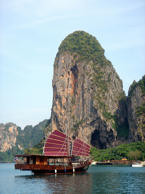 Traditional junk boat anchored in front of Phra Nang beach, Krabi, Thailand