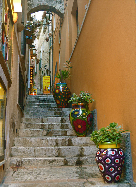 Flower vases on the streets of Taormina / Italy